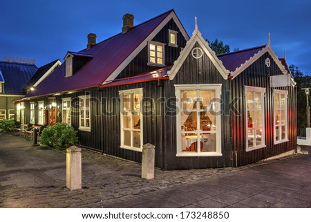 Traditional old house on Laugavegur Street in Reykjavik, Iceland at twilight time. - stock photo