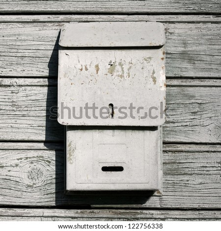 Traditional old mail box on the wooden wall - stock photo