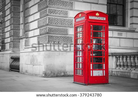 Traditional old style British red telephone box in London, UK - black & white version - stock photo