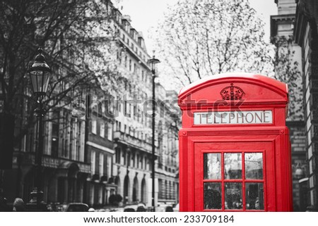 Traditional old style UK red phone box in London, effect vintage black and white