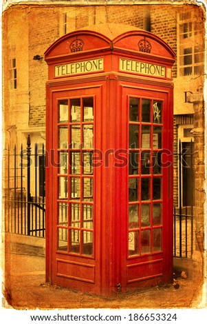 Traditional old style UK red phone boxes in London - stock photo