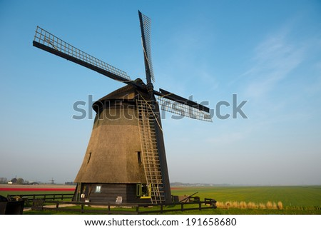 Traditional old windmill - stock photo