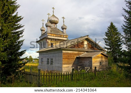 traditional old wooden church behind the fence, Russia, Karelia, village Virma, 2014  - stock photo
