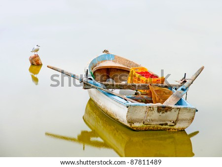Traditional old wooden fishing boat in the lake Orestiada in Kastoria city of northern Greece - stock photo