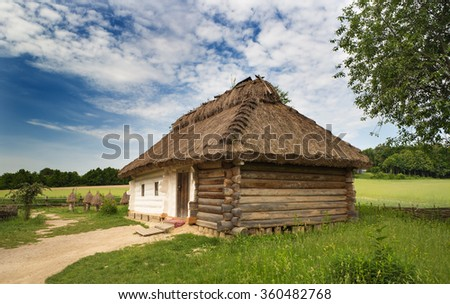 Traditional old wooden house in Ukrainian countryside,Ukraine - stock photo