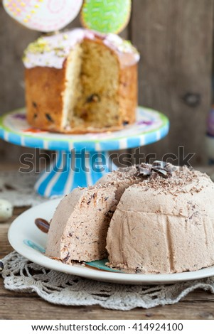 Traditional Orthodox Easter dessert made cottage cheese with chocolate and prunes on a wooden background. Selective focus. - stock photo