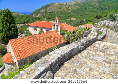 Traditional orthodox monastery with small stone churches located in the Adriatic sea area, Montenegro - stock photo