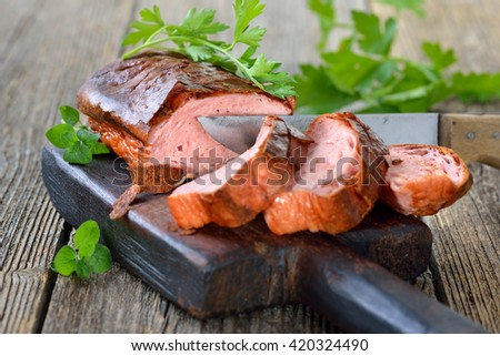 Traditional oven fresh Bavarian meat loaf on a wooden cutting board