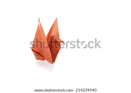 Traditional paper origami crane or tsuru a symbol of happiness peace and good luck studio isolated - stock photo