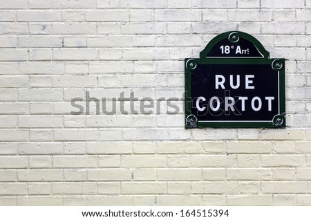Traditional Paris plaque with the name of the street on white brick wall - stock photo