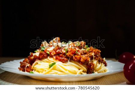 Traditional pasta spaghetti bolognese on dark wooden background. with copy space.