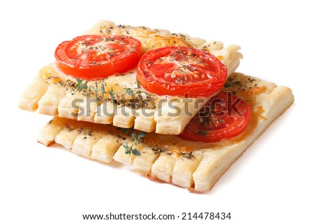 Traditional pastry puff tarts with tomato, cheese and thyme isolated on white background   - stock photo