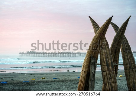 Traditional Peruvian small Reed Boats (Caballitos de Totora), straw boats still used by local fishermens in Peru - stock photo