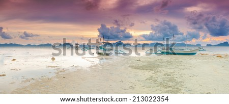 Traditional philippine boats bangka at sunset time. Panorama - stock photo