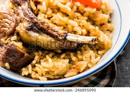 Traditional Pilaf with Lamb Chops, Onion, and Carrot - stock photo