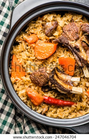 Traditional Pilaf with Lamb Chops, Onion, and Carrot