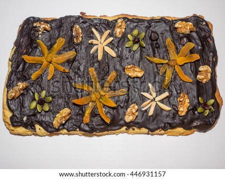 Traditional Polish cake make for Easter with variety of toppings. Mazurek is usually colourfully iced and decorated with jam, nuts and raisins.