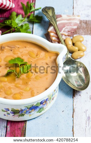 Traditional Polish cuisine:butter beans with tomatoes, bacon and marjoram (Breton beans) - stock photo
