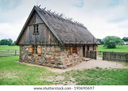 Traditional polish house on a farmyard.