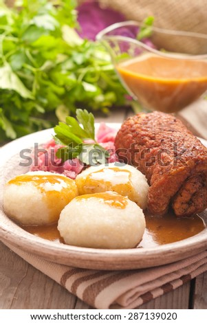 Traditional Polish, Silesian dish. Meat roulade with potato dumplings and red cabbage. - stock photo