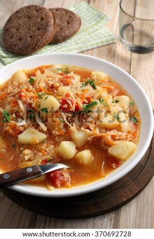 Traditional Polish soup kapusnyak on a rustic table