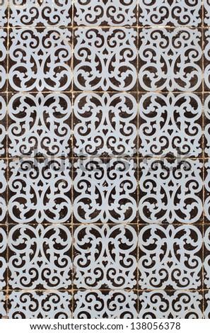 Traditional Portuguese azulejos - painted ceramic tilework - stock photo