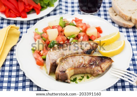 traditional portuguese dish grilled tuna belly with salad - stock photo