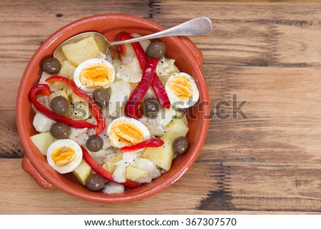 traditional portuguese dish on ceramic plate on brown background - stock photo