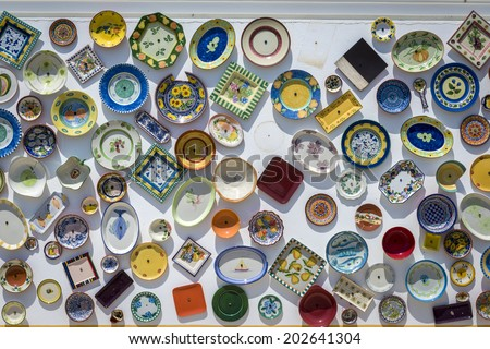 Traditional Portuguese handcrafted, colorful decorated plates on the wall