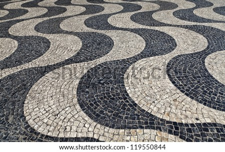 Traditional Portuguese pavement in Rossio Square, Lisbon, Portugal - stock photo