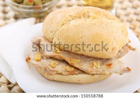 "traditional portuguese pork beef sandwich ""bifana"" - stock photo"