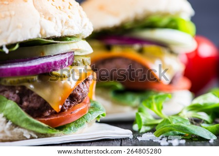 traditional pub style burger  on wooden table - stock photo