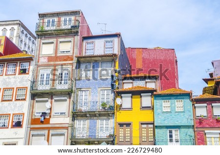 Traditional quaint houses in the old town and touristic ribeira district of Porto in panoramic, Portugal - stock photo