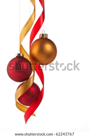 Traditional red and gold Christmas ball ornaments with ribbons on white - stock photo