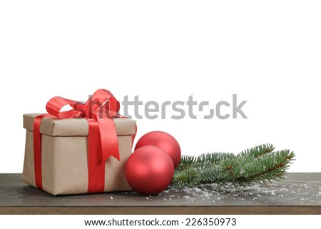 traditional red balls and fir branch on wood table, white background
