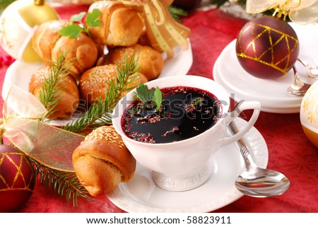 traditional red borscht and yeast pastries with mushrooms filling for christmas eve - stock photo