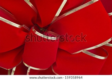 Traditional Red Christmas Ribbon - Traditional Red Christmas Ribbon For Wallpaper or Background - stock photo