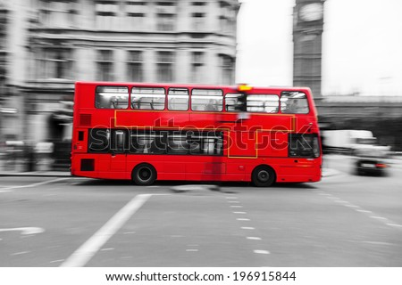 traditional red double decker bus in London in motion blur and in a chroma key processing - stock photo