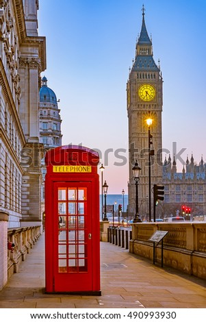Traditional red phone booth and Big Ben in London