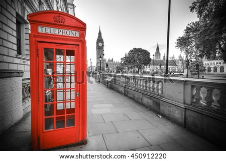 Traditional red phone box in London with the Big Ben in the background - stock photo