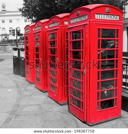 traditional red phone boxes in London altered with a chroma key processing