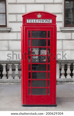 Traditional red telephone booth in London - stock photo