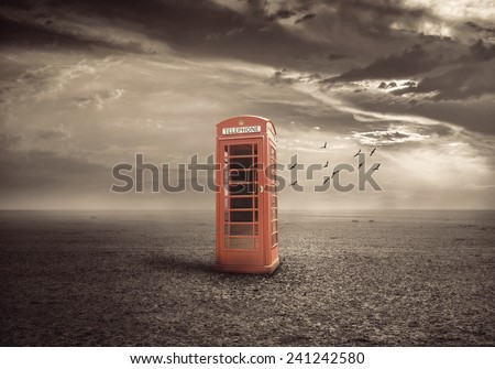 traditional red telephone booth or public payphone - stock photo