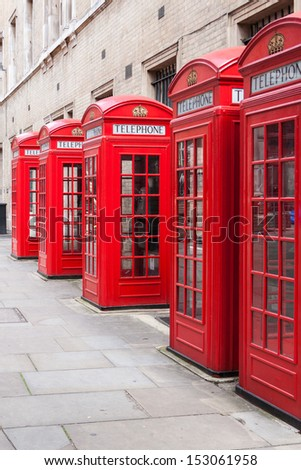 Traditional red telephone booths in London - stock photo