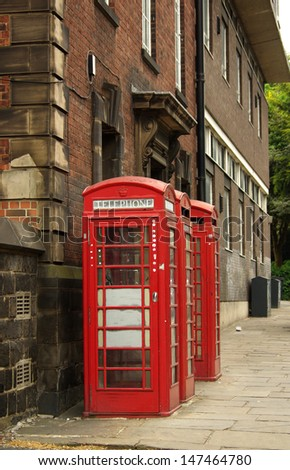 Traditional red telephone box in Leeds, UK  - stock photo