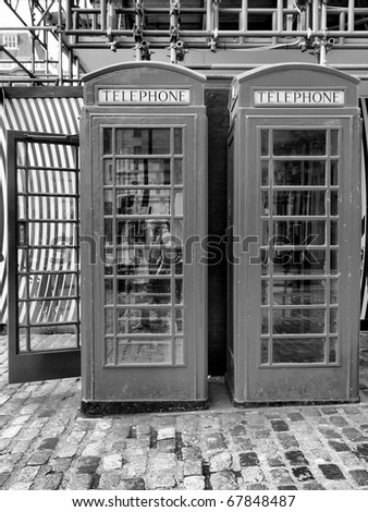 Traditional red telephone box in London, UK - high dynamic range HDR - black and white