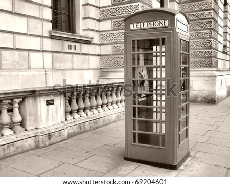 Traditional red telephone box in London, UK - high dynamic range HDR - black and white - stock photo