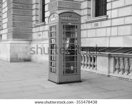 Traditional red telephone box in London, UK in black and white