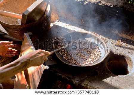 traditional roasting coffe in bowl on open fire, Bali, Indonesia - stock photo