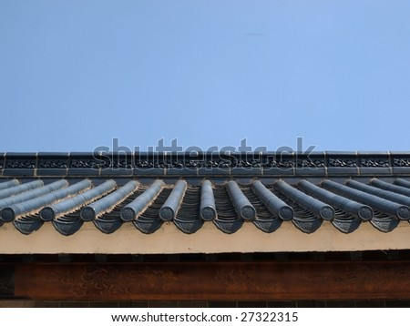 Traditional roof of ancient Chinese building. - stock photo